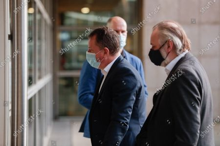 Britain's Chief Negotiator of Task Force Europe David Frost (L) and Britain's ambassador to the European Union Tim Barrow arrive at the European Commission ahead of a meeting with European Union (EU)'s Chief Negotiator Michel Barnier (unseen) on Brexit negotations in Brussels, Belgium, 13 December 2020. A negotiations phase of eleven months that started on 31 January 2020 following the UK's exit from the EU ends on 31 December 2020.