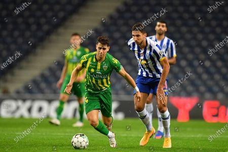Marko Grujic of FC Porto beaten by the run from Naoufel Khacef of Tondela; Estadio do Dragao, Porto, Portugal; Taça De Portugal Football, FC Porto versus Tondela.