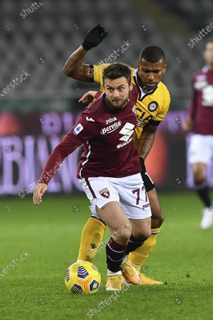 "Karol Linetty (Torino) Walace Souza Silva (Udinese)           during the Italian ""Serie A"" match between Torino 2-3 Udinese  at  Olimpic Stadium in Torino, Italy."