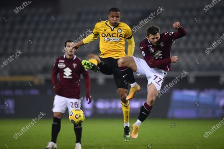 "Karol Linetty (Torino) Rodrigo Becao (Udinese)           during the Italian ""Serie A"" match between Torino 2-3 Udinese  at  Olimpic Stadium in Torino, Italy."