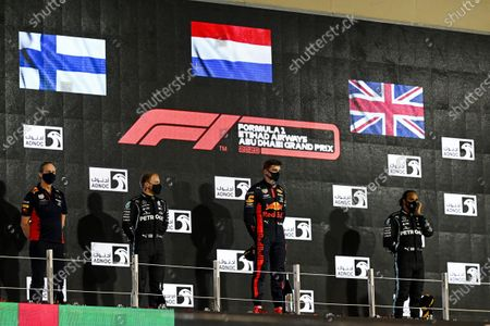 Paul Monaghan, Chief Engineer, Red Bull Racing, Valtteri Bottas, Mercedes-AMG Petronas F1, Race Winner Max Verstappen, Red Bull Racing and Lewis Hamilton, Mercedes-AMG Petronas F1 on the podium during the 2020 Formula One Abu Dhabi Grand Prix
