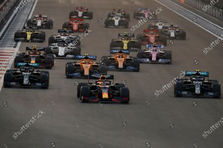 Red Bull driver Max Verstappen of the Netherlands, centre, in action between Mercedes driver Lewis Hamilton of Britain and Mercedes driver Valtteri Bottas of Finland during the Formula One at the Yas Marina racetrack in Abu Dhabi, United Arab Emirates, Sunday, Dec.13, 2020