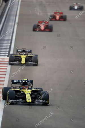Stock Photo of Renault driver Esteban Ocon of France in action in front of Renault driver Daniel Ricciardo of Australia and Ferrari driver Sebastian Vettel of Germany and Ferrari driver Charles Leclerc of Monaco during the Formula race in the Yas Marina racetrack in Abu Dhabi, United Arab Emirates, Sunday, Dec.13, 2020