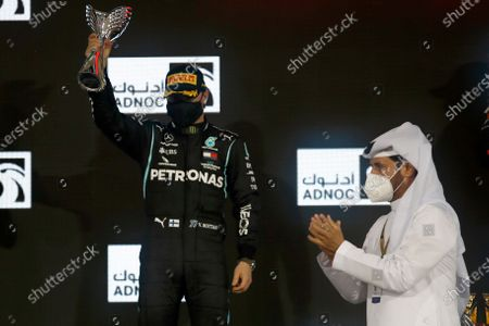 Mercedes driver Valtteri Bottas of Finland celebrates on the podium after the Formula One at the Yas Marina racetrack in Abu Dhabi, United Arab Emirates, Sunday, Dec.13, 2020
