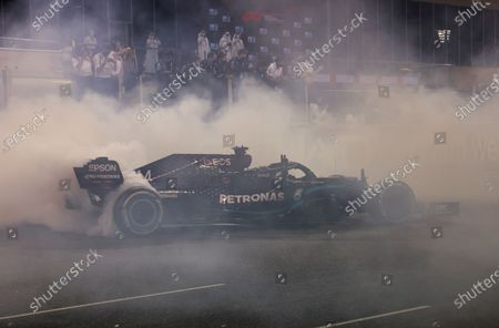 Mercedes driver Lewis Hamilton of Britain burns tires after the Formula One Abu Dhabi Grand Prix in Abu Dhabi, United Arab Emirates