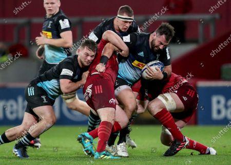 Munster vs Harlequins. Munster's Kevin O'Byrne and Peter O'Mahony tackle Scott Baldwin of Harlequins