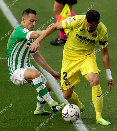 Stock Picture of Betis' midfielder Andres Guardado (L) duels for the ball against Villarreal's defender Mario Gaspar (R) during the Spanish LaLiga soccer match between Real Betis and Villarreal CF at Benito Villamarin stadium in Seville, Andalusia, Spain, 13 December 2020.