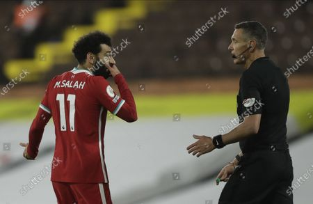 Mohamed Salah (L) of Liverpool argues with referee Andre Marriner (R) during the English Premier League soccer match between Fulham FC and Liverpool FC in London, Britain, 13 December 2020.