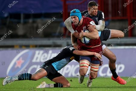 Munster vs Harlequins. Munster's Tadhg Beirne is tackled by Marcus Smith and Nathan Earle of Harlequins