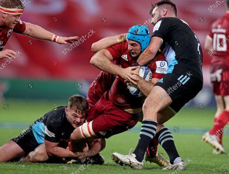 Munster vs Harlequins. Munster's Tadhg Beirne is tackled by William Evans and Scott Baldwin of Harlequins
