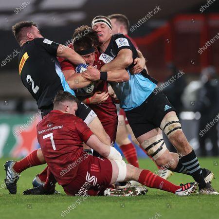 Munster vs Harlequins. Munster's CJ Stander is tackled by Scott Baldwin and Glen Young of Harlequins