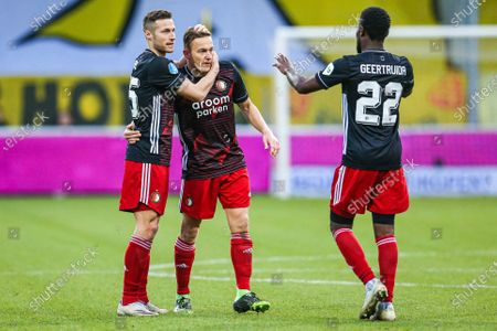 Stock Image of (L-R) Feyenoord Rotterdam players Uros Spajic, Jens Toornstra and Lutsharel Geertruida celebrate the 0-1 goal during the Dutch Eredivisie match between VVV Venlo and Feyenoord Rotterdam in Venlo, The Netherlands, 13 December 2020.