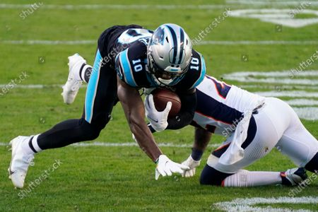 Carolina Panthers wide receiver Curtis Samuel is tackled by Denver Broncos safety Kareem Jackson during the second half of an NFL football game, in Charlotte, N.C