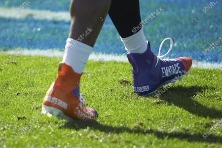 Closeup of the cleats worn by Carolina Panthers tight end Ian Thomas (80) prior to an NFL football game against the Denver Broncos, in Charlotte, N.C