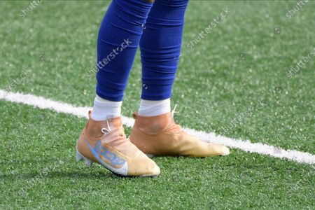 New York Giants' Golden Tate warms-up wearing special cleats before an NFL football game against the Arizona Cardinals, in East Rutherford, N.J