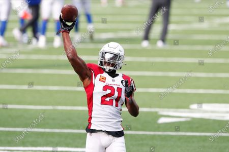 Arizona Cardinals' Patrick Peterson warms-up before an NFL football game against the New York Giants, in East Rutherford, N.J
