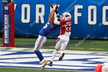 New York Giants' Golden Tate, left, catches a pass in front of Arizona Cardinals' Byron Murphy during the second half of an NFL football game, in East Rutherford, N.J
