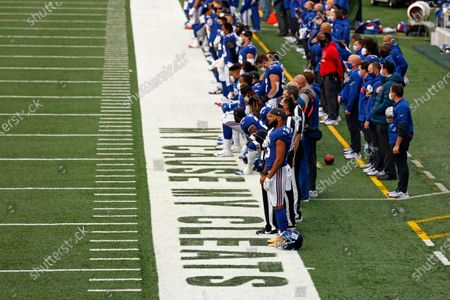 New York Giants wide receiver Golden Tate (15) stands for the national anthem before an NFL football game against the Arizona Cardinals, in East Rutherford, N.J