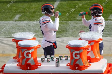 Chicago Bears punter Pat O'Donnell, left, and long snapper Patrick Scales, right, drink Gatorade before an NFL football game against the Houston Texans, in Chicago