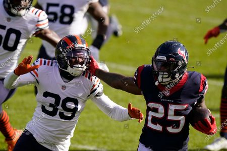 Stock Picture of Houston Texans' Duke Johnson (25) is chased by Chicago Bears' Eddie Jackson (39) during the first half of an NFL football game, in Chicago