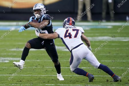 Carolina Panthers running back Rodney Smith is tackled by Denver Broncos linebacker Josey Jewell during the second half of an NFL football game, in Charlotte, N.C