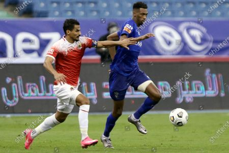 Al-Hilal's player Mohamed Kanno (R) in action against Al-Wehda's Waleed Bakshween (L) during the Saudi Professional League soccer match between Al-Hilal and Al-Wehda at King Fahd International Stadium, in Riyadh, Saudi Arabia, 13 December 2020.