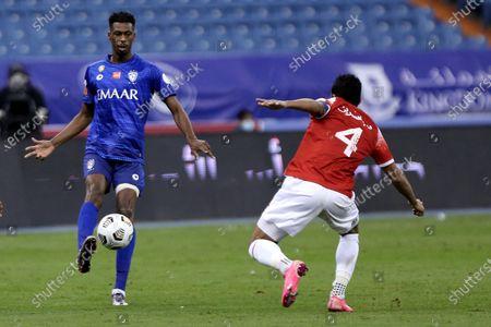 Al-Hilal's player Mohamed Kanno (L) in action against Al-Wehda's Waleed Bakshween (R) during the Saudi Professional League soccer match between Al-Hilal and Al-Wehda at King Fahd International Stadium, in Riyadh, Saudi Arabia, 13 December 2020.