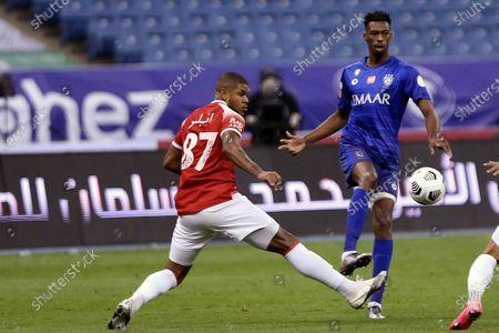 Al-Hilal's player Mohamed Kanno (R) in action against Al-Wehda's Anselmo (L) during the Saudi Professional League soccer match between Al-Hilal and Al-Wehda at King Fahd International Stadium, in Riyadh, Saudi Arabia, 13 December 2020.