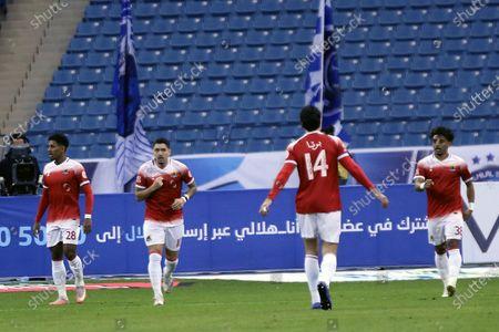 Al-Wehda's player Dimitri Petratos (2-L) celebrates with teammates after scoring a goal during the Saudi Professional League soccer match between Al-Hilal and Al-Wehda at King Fahd International Stadium, in Riyadh, Saudi Arabia, 13 December 2020.