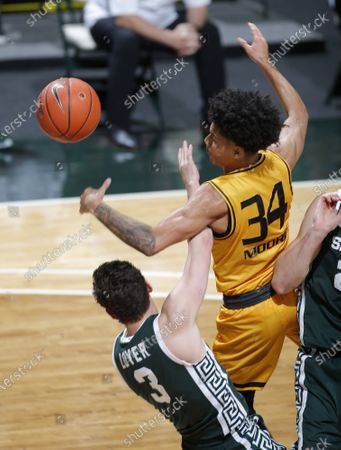 Editorial image of Oakland Michigan St Basketball, East Lansing, United States - 13 Dec 2020