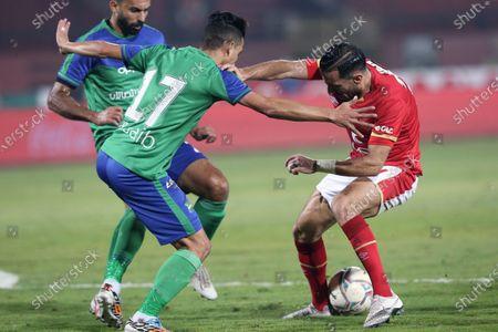 Al Ahly's Ali Maaloul (R) in action against Misr Lel Makkasa's Essam Sobhy (L) during the Egyptian Premier League soccer match between Al Ahly SC and Misr Lel Makkasa SC at Salam Stadium in Cairo, Egypt, 13 December 2020.