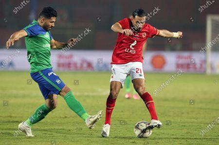 Al Ahly's Ali Maaloul (R) in action against Misr Lel Makkasa's Asem Said (L) during the Egyptian Premier League soccer match between Al Ahly SC and Misr Lel Makkasa SC at Salam Stadium in Cairo, Egypt, 13 December 2020.