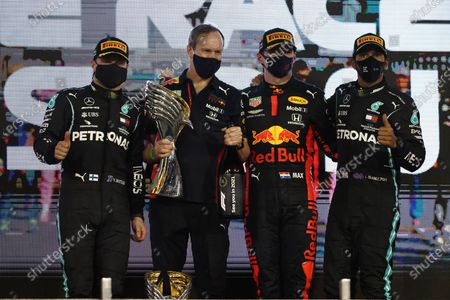 Stock Picture of Valtteri Bottas, Mercedes-AMG Petronas F1, 2nd position, Paul Monaghan, Chief Engineer, Red Bull Racing, Max Verstappen, Red Bull Racing, 1st position, and Lewis Hamilton, Mercedes-AMG Petronas F1, 3rd position, on the podium during the 2020 Formula One Abu Dhabi Grand Prix