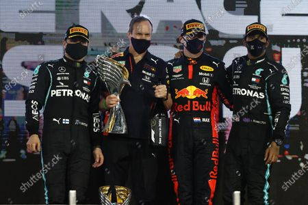 Valtteri Bottas, Mercedes-AMG Petronas F1, 2nd position, Paul Monaghan, Chief Engineer, Red Bull Racing, Max Verstappen, Red Bull Racing, 1st position, and Lewis Hamilton, Mercedes-AMG Petronas F1, 3rd position, on the podium during the 2020 Formula One Abu Dhabi Grand Prix