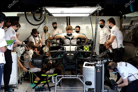 Mercedes mechanics work on the car of Valtteri Bottas, Mercedes F1 W11 EQ Performance during the 2020 Formula One Abu Dhabi Grand Prix
