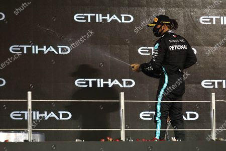 Lewis Hamilton, Mercedes-AMG Petronas F1, 3rd position, sprays Champagne on the podium during the 2020 Formula One Abu Dhabi Grand Prix