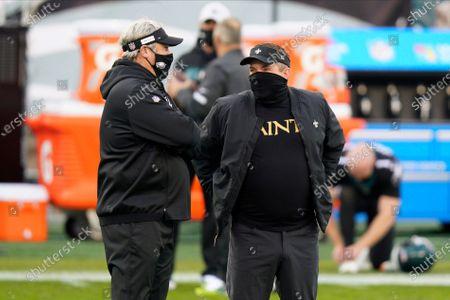 Philadelphia Eagles head coach Doug Pederson left, and New Orleans Saints head coach Sean Payton meet before an NFL football game, in Philadelphia