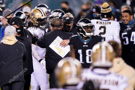 Philadelphia Eagles head coach Doug Pederson, right, and New Orleans Saints' Sean Payton meet after an NFL football game, in Philadelphia