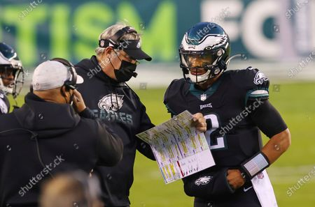 Philadelphia Eagles' head coach Doug Pederson talks with quarterback Jalen Hurts (2) during an NFL football game against the New Orleans Saints, in Philadelphia