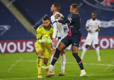 Lyon's goalkeeper Anthony Lopes, left, and Mattia De Sciglio, second from left, are fouled by PSG's Neymar during the League One soccer match between Paris Saint Germain and Lyon, at the Parc des Princes stadium in Paris, France