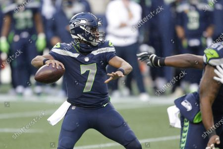 Seattle Seahawks quarterback Geno Smith drops back to pass against the New York Jets during the second half of an NFL football game, in Seattle