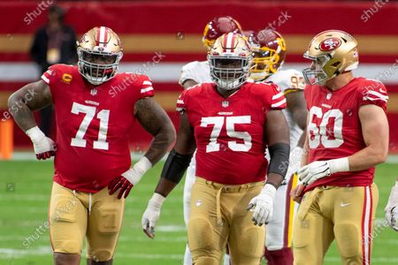 San Francisco 49ers offensive tackle Trent Williams (71), offensive guard Laken Tomlinson (75) and offensive guard Daniel Brunskill (60) stand on the field during an NFL football game against the Washington Football Team, in Glendale, Ariz