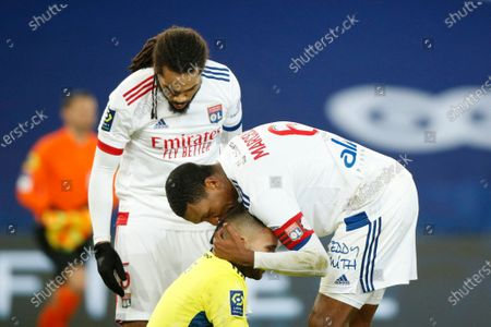 Lyon's Jason Denayer (L), Lyon's Marcelo (R) and Lyon's goalkeeper Anthony Lopes (down) celebrate their win following the French Ligue 1 soccer match between PSG and Lyon at the Parc des Princes stadium in Paris, France, 13 December 2020.