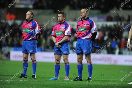 File pic of referee Nigel Owens who has announced his retirement from international rugby after being ref for 100 tests.Swansea -UK - 25th October 2013 - RaboDirect PRO12 - Ospreys v Newport Gwent Dragons at the Liberty Stadium in Swansea : Referee Nigel Owens (middle) with linesmen ahead of kick off.
