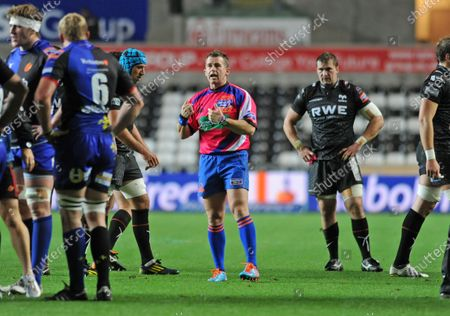 File pic of referee Nigel Owens who has announced his retirement from international rugby after being ref for 100 tests.Swansea -UK - 25th October 2013 - RaboDirect PRO12 - Ospreys v Newport Gwent Dragons at the Liberty Stadium in Swansea : Referee Nigel Owens speaking to players.