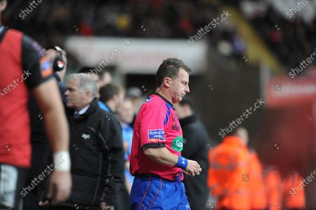 File pic of referee Nigel Owens who has announced his retirement from international rugby after being ref for 100 tests.Swansea -UK - 25th October 2013 - RaboDirect PRO12 - Ospreys v Newport Gwent Dragons at the Liberty Stadium in Swansea : Referee Nigel Owens walks onto the field of play.