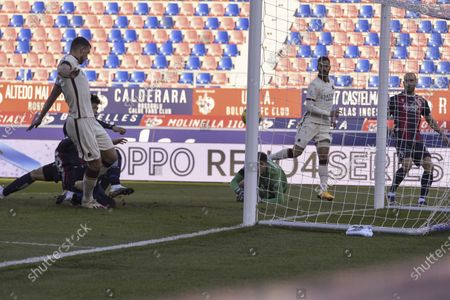 "Andrea Poli (Bologna)Edin Dzeko (Roma)Takehiro Tomiyasu (Bologna)  he scored the first goal for his team         during the Italian  Serie A"" match between Bologna 1-5 Roma at  Renato Dall Ara Stadium on December 13 , 2020 in Bologna, Italy."