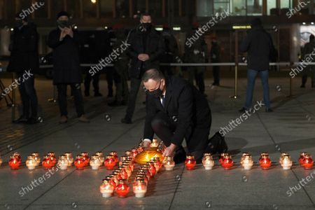 Polish President Andrzej Duda lights a candle as he marks the 39th anniversary of the imposition of martial law in Poland in a special address on Warsaw's Pilsudskiego Square, Warsaw, Poland, 13 December 2020. Poland's communist government imposed martial law on 13 December 1981, in a bid to quell the rising Solidarity trade union. At least 91 people were killed during the martial law period that ended on 22 July 1983.