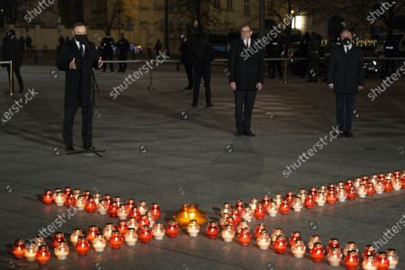 Polish President Andrzej Duda (L) speaks as he marks the 39th anniversary of the imposition of martial law in Poland in a special address on Warsaw's Pilsudskiego Square, Warsaw, Poland, 13 December 2020. Poland's communist government imposed martial law on 13 December 1981, in a bid to quell the rising Solidarity trade union. At least 91 people were killed during the martial law period that ended on 22 July 1983.