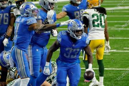 Detroit Lions wide receiver Marvin Jones (11) pats running back Kerryon Johnson (33) after his 2-yard touchdown run during the second half of an NFL football game against the Green Bay Packers, in Detroit